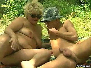 German BBW granny takes young cock outdoors