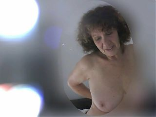 Passionate granny is nude at home