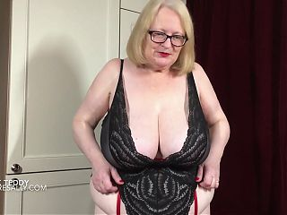 Sally plays with her dildo in her black teddy