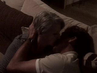 Mature wife kisses young neighbor