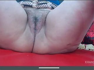 Granny flashes hairy pussy
