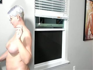Blonde granny plays with herself.